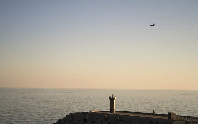 In this photo taken on Tuesday, March 1, 2016, a Russian Su-24 bomber flies over the Mediterranean sea in Latakia, Syria. (AP/Vladimir Isachenkov)