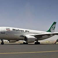 A Yemeni airport security official walks on the tarmac next to a plane from the Iranian private airline Mahan Air at the international airport in Sanaa, Yemen, March 1, 2015 (AP Photo/Hani Mohammed)