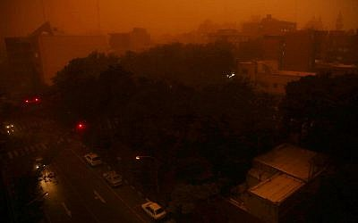 A view of Tehran, Iran, Monday, June 2, 2014, when  a flash dust storm hits the Iranian capital. (AP Photo/Ebrahim Noroozi)