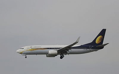 In this April 16, 2015 photo, passenger Airbus of India's Jet Airways prepares for a landing at the Indira Gandhi International airport in New Delhi, India. (AP Photo/Altaf Qadri)