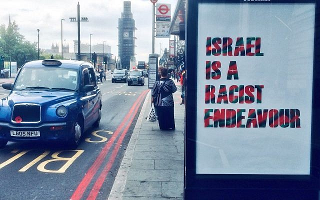 A London bus stop defaced with an unauthorized poster reading, 'Israel is a racist endeavor,' which a pro-Palestinian group put up in protest at the UK Labour Party's adoption of the IHRA definition of anti-Semitism, on September 6, 2018. (Twitter)