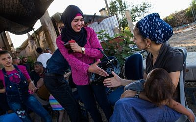 Illustrative: Israeli Jews and Palestinians talk to each other during a coexistence meeting in the West Bank, on July 22, 2015 (Nati Shohat/Flash90)