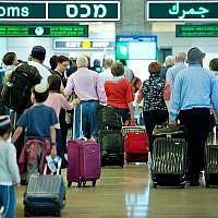 Illustrative image of travelers seen at the arrival hall of Ben Gurion International Airport, near Tel Aviv, on April 11, 2018. (Moshe Shai/FLASH90)