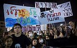 Thousands attend a protest in Tel Aviv, against the plan to build gas rig 10 kilometers from the Israeli coastline on September 1, 2018. The signs read 'don't poison us.' (Miriam Alster/FLASH90)