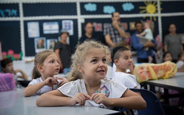 First-grade students sit in a classroom on their first day of school at Efrata elementary school in Jerusalem, on September 2, 2018. (Hadas Parush/Flash90)