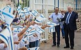 """President Reuven Rivlin visits students at the Religious school """"Noam Eliyahu"""" in the southern Isralei city of Netivot, on the first day of school on September 2, 2018. (Mark Neyman/GPO)"""