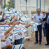 "President Reuven Rivlin visits students at the Religious school ""Noam Eliyahu"" in the southern Israeli city of Netivot, on the first day of school on September 2, 2018. (Mark Neyman/GPO)"