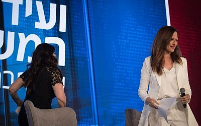 Monica Lewinsky (L) walks out of an onstage interview with Yonit Levi of Hadashot news in Jerusalem on September 3, 2018. (Yonatan Sindel/Flash90)