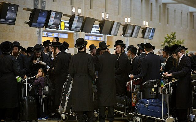 Ultra-Orthodox Jewish men traveling to Uman in the Ukraine for the Jewish new year holiday of Rosh Hashanah, seen at Ben Gurion Airport near Tel Aviv, on September 5, 2018. (Avi Dishi/Flash90)