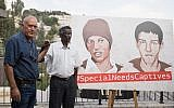 The brother of Avera Mengistu (r) and father of Hisham al-Sayad pose for a picture as they hold a press conference calling for the release of the two Israeli citizens from Hamas captivity, on September 6, 2018. (Hadas Parush/FLASH90)