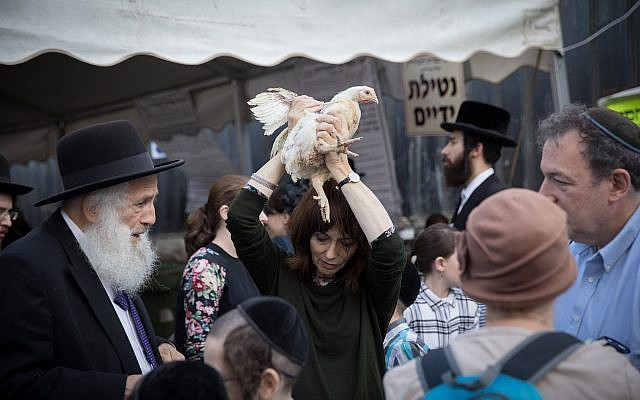 Ultra Orthodox Jews perform the kaparot ritual on September 16, 2018, in the ultra orthodox neighborhood of Me'a Shearim, in Jerusalem.  (Noam Revkin Fenton/Flash90)