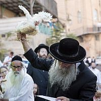 Ultra-Orthodox Jews perform the kaparot ritual on September 16, 2018, in the ultra- Orthodox neighborhood of Mea Shearim, in Jerusalem.  (Noam Revkin Fenton/Flash90)
