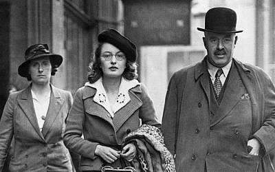 A woman fascist, center, being arrested at the Fascist headquarters in London on May 23, 1940. (AP Photo)