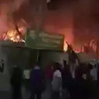 A screen capture from video on social media shows Iraqi protesters outside the Iranian consulate in Basra after it was set ablaze during anti-government demonstrations on September 7, 2018. (Screen capture: Twitter)