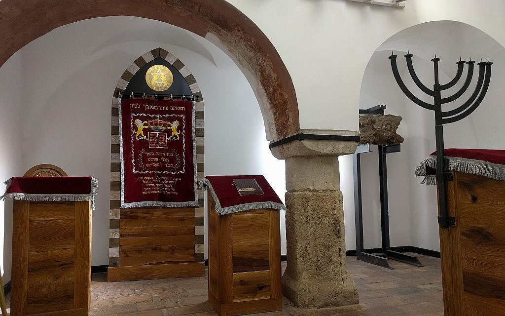 The interior of the Medieval Jewish Prayer House, which will serve as Rabbi Asher Faith's new congregation. A new ark, dais, and other furnishings have been added. (Yaakov Schwartz/ Times of Israel)