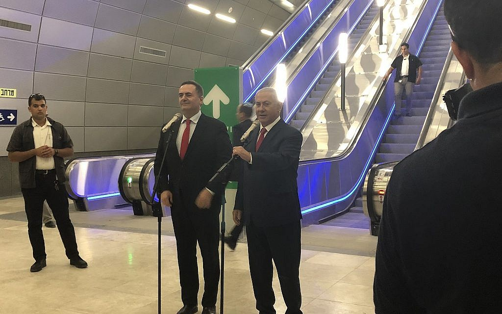 Prime Minister Benjamin Netanyahu (r) and Transportation and Intelligence Minister Israel Katz speak at the official opening of the Jerusalem Yitzhak Navon Station for the high-speed train to Tel Aviv on September 20, 2018. (Sue Surkes/ Times of Israel)