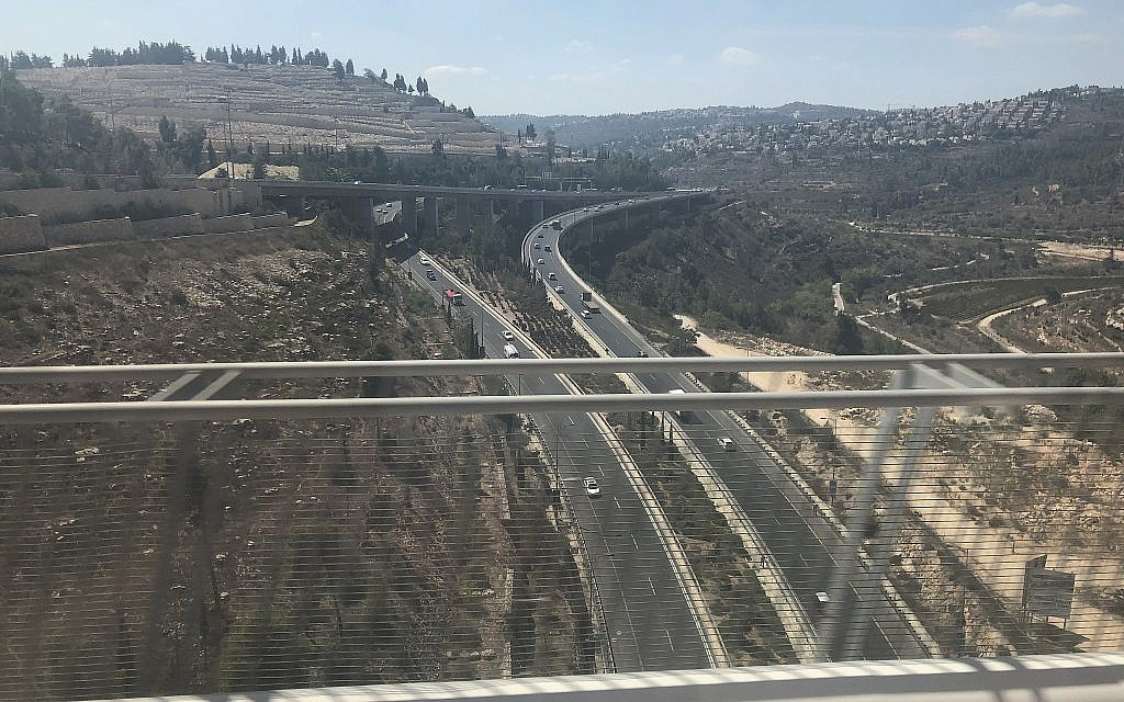 A view of the Route 1 highway from the new Jerusalem to Ben Gurion Airport fast railway line, September 20, 2018. (Sue Surkes/Times of Israel)
