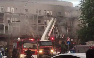 Rescue workers are seen at the scene of a fire at a building in Jaffa on September 2, 2019. (Screen capture: Ynet)
