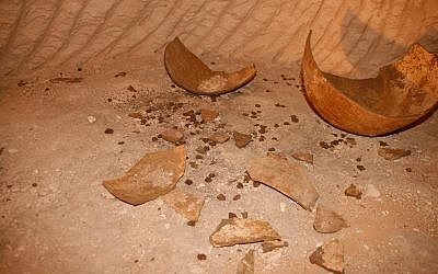 Smashed pottery and dozens of clay sealings found in one of the seven newly discovered rooms of a subterranean complex in the ancient Hellenistic-era city of Maresha, near Beit Guvrin. (Asaf Stern)
