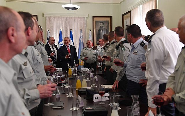 Prime Minister Benjamin Netanyahu at a Rosh Hashanah toast with top defense officials at the Defense Ministry headquarters in Tel Aviv on September 6, 2018. (Kobi Gideon/GPO)