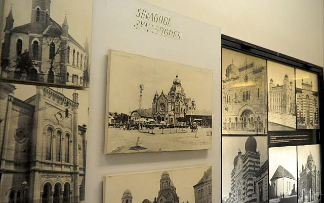 Photographs of historic synagogues throughout the former Yugoslavia are on display at the Jewish Historical Museum in Belgrade, June 2018. (Larry Luxner/Times of Israel)
