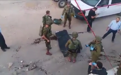 Israeli soldiers respond to an attempted stabbing attack in the West Bank settlement of Kiryat Arba, near Hebron, on September 3, 2018. (Screen capture/Twitter)