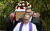Mourners carry a casket holding the remains of Frank Le Villio during a reburial ceremony at a church in St. Helier, Jersey, on September 5, 2018. (Screen capture: YouTube)