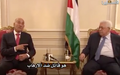 Former prime minister Ehud Olmert meets with Palestinian Authority President Mahmoud Abbas in Paris on September 21, 2018 (YouTube screenshot)