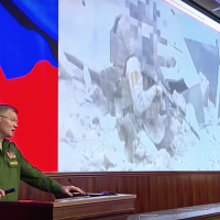 Russian defense ministry spokesman  Maj. Gen. Igor Konashenkov gives a briefing on the downing of a Russian Il-20 military plane near Syria, on September 23, 2018. (Screen capture: Russia Today)