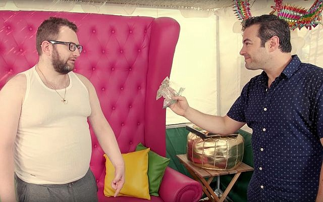 Eli Batalion, left, as Leizer, and Jamie Elman, as Chaimie, discuss their favorite sukkah activities in the web series 'YidLife Crisis.' (Courtesy)