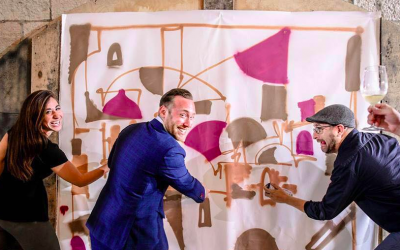 Members of The Israel Innovation Fund, creating original works of art with the help of artist-in-residence, Solomon Souza (Courtesy TIIF)