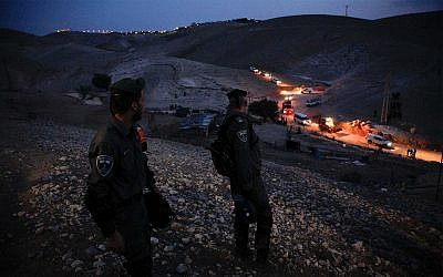 Israeli security forces arrive to the West Bank Bedouin community of Khan al-Ahmar, Thursday, September 13, 2018. (Majdi Mohammed/AP)