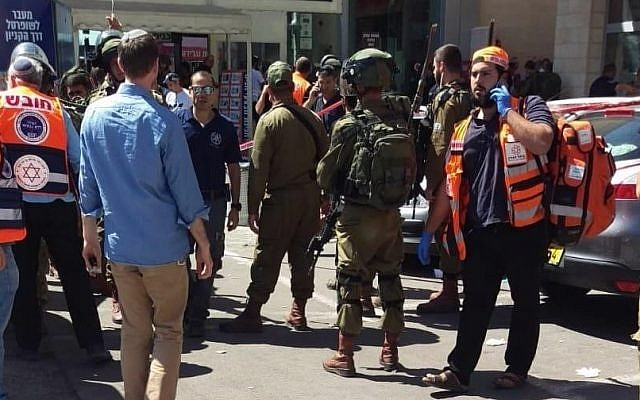 Illustrative: Security forces arrive at the scene after an Israeli man was stabbed in a terrorist attack at a shopping mall next to the Gush Etzion Junction on September 16, 2018. (United Hatzalah)