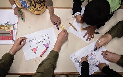 Syrian children color inside a facility run by the army's 'Operation Good Neighbor' project, which helped thousands of Syrians before Israel shut it down after Syrian dictator Bashar Assad took control of the area bordering the Golan Heights. (Israel Defense Forces)
