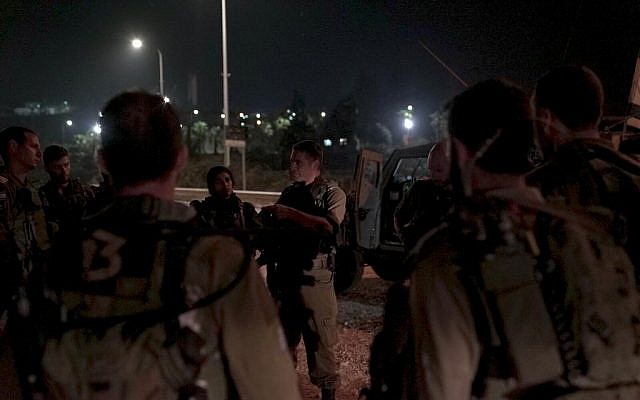 IDF soldiers conduct a raid in the West Bank village of Yatta, near Hebron, on September 17, 2018. (Israel Defense Forces)