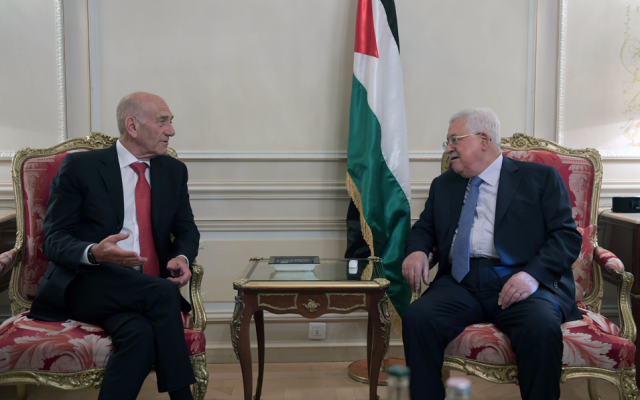 Former Israeli prime minister Ehud Olmert and Palestinian Authority President Mahmoud Abbas meet in Paris, September 21, 2018 (Wafa news agency)