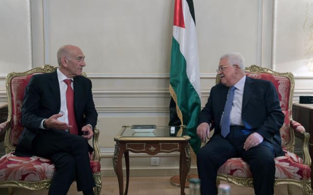 Former Israeli prime minister Ehud Olmert and Palestinian Authority President Mahmoud Abbas meet in Paris, September 21, 2018 (Wafa news agency)