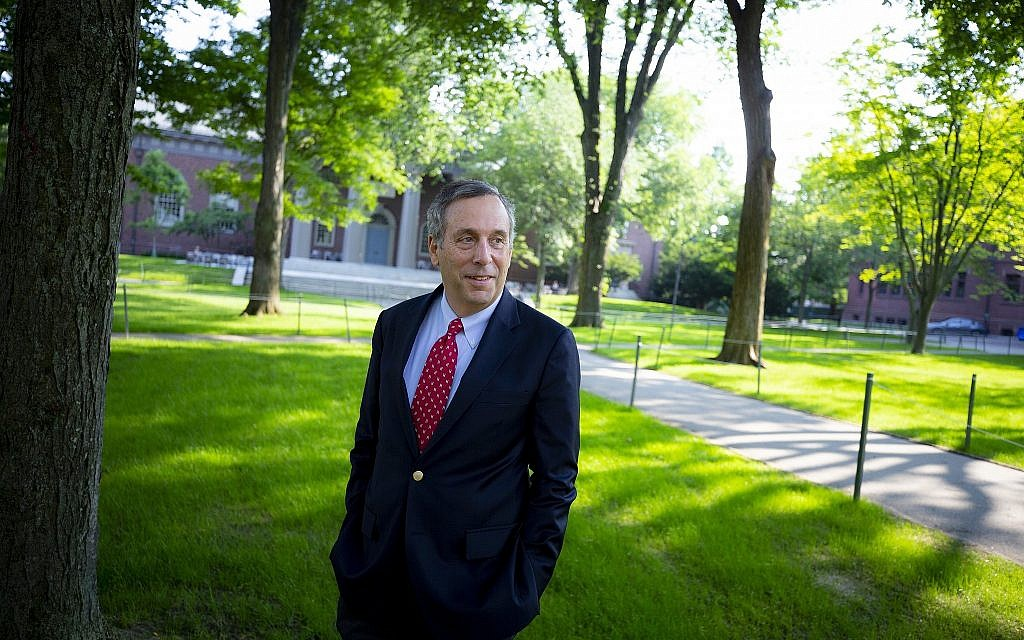 Lawrence Bacow, the 29th Harvard University president, walks through Harvard Yard on his first day in office, July 2018. (Rose Lincoln/Harvard Staff Photographer, via JTA)