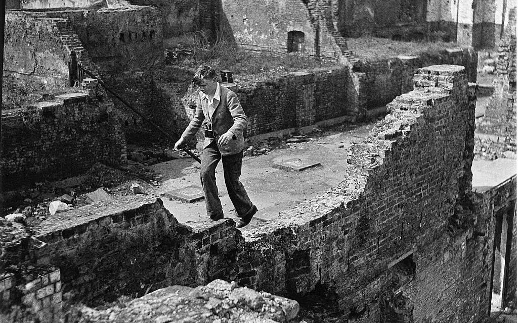 Photo of a boy running over ruins, by Edith Tudor-Hart. (Suschitzky family)