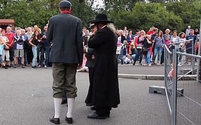 A municipally organized street show in Prague on September 2 , 2018 celebrating Czech nationhood featured a skit apparently mocking an Orthodox Jew with anti-Semitic stereotypes (Screencapture/Facebook)