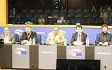 Mark Meechan (2l), who taught a dog to give a Nazi salute, speaks at a UKIP conference in the European Parliament. (Screen capture: YouTube)