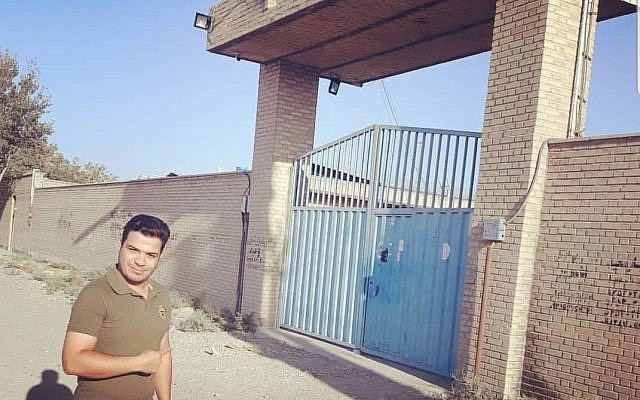 An Iranian poses outside the site identified by Prime Minister Benjamin Netanyahu as a secret Iranian nuclear facility on September 28, 2018 (Twitter)