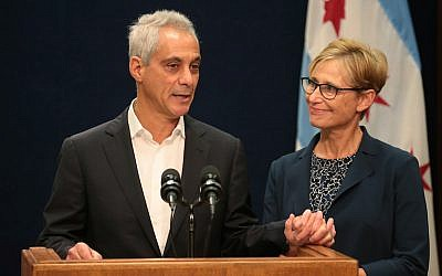 With wife Amy Rule by his side, Chicago Mayor Rahm Emanuel announces Tuesday, September 4, 2018 he will not seek a third term in office at a press conference on the 5th floor at City Hall in Chicago. (Stacey Wescott/Chicago Tribune/TNS via Getty Images/via JTA)