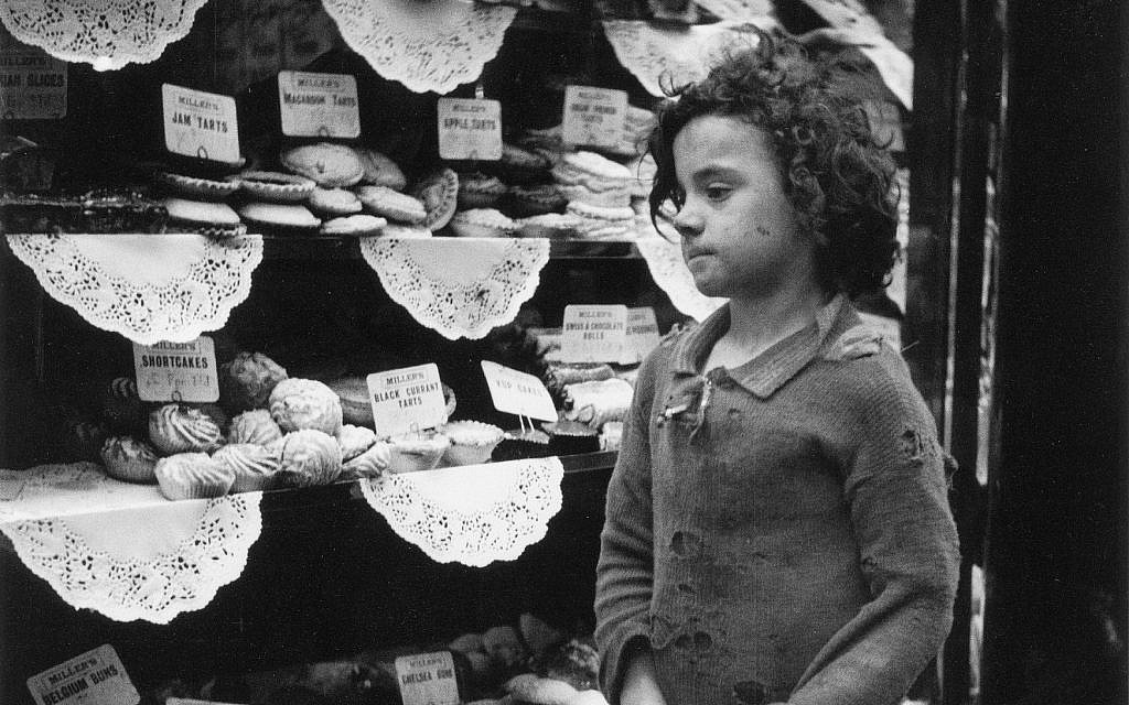 A girl in front of a bakery, by Edith Tudor-Hart. (Suschitzky family)