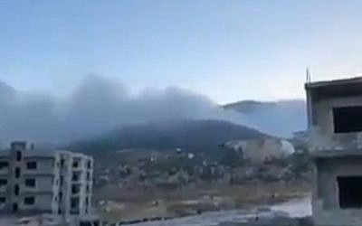 Smoke rises after an alleged Israeli strike near Hama, Syria, on September 4, 2018. (screen capture: Twitter)