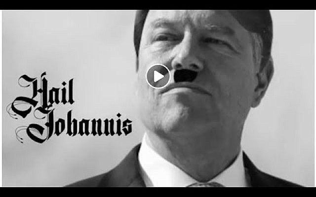 A clip shows an altered photo of Romanian President Klaus Iohannis, a strong government critic and ethnic German, sporting a hairstyle and moustache like Adolf Hitler. (Screenshot/Facebook)