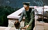 Adolf Hitler and a child at his alpine home, the Berghof (public domain)