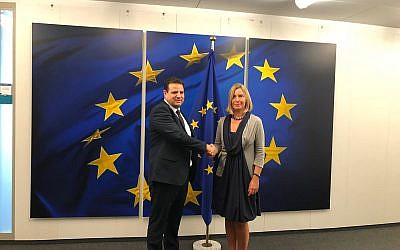 Joint (Arab) List chairman MK Ayman Oudeh, left, with EU foreign policy chief Federica Mogherini in Brussels, September 4, 2019 (courtesy Joint List)