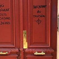 "Anti-Semitic graffiti reading ""Jewish scum live here,"" on a building in Paris. ""Notably on the third floor,"" it adds on the other side of the door, above a drawing of a target. (Twitter)"