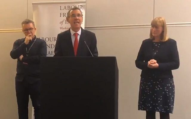 Israel ambassador to the UK Mark Regev (c) addresses a 2018 Labour Friends of Israel meeting, flanked by Labour party deputy leader Tom Watson (l) and LFI chair Joan Ryan. (Screen capture: Twitter)